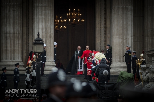 Maggie's coffin being carried up the steps into St Paul's Cathedral.