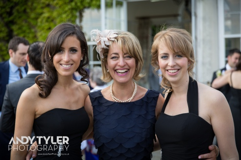 Two bridesmaid sisters and mother