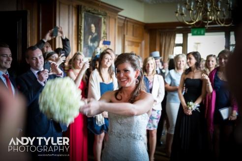 Dani tosses the bridal bouquet